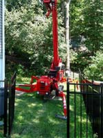 Our turf friendly spiderlift fits through a standard size gate and is gentle to your property